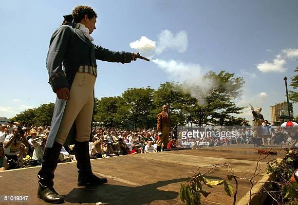 Antonio Burr a descendant of Aaron Burr's cousin fires with Douglas Hamilton a fiithgreatgrandson of Alexander Hamilton during a reenactment marking...