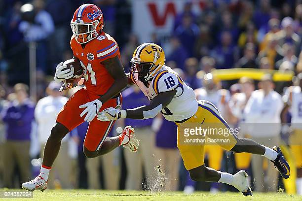 Antonio Callaway of the Florida Gators runs with the ball as Tre'Davious White of the LSU Tigers defends during the first half of a game at Tiger...