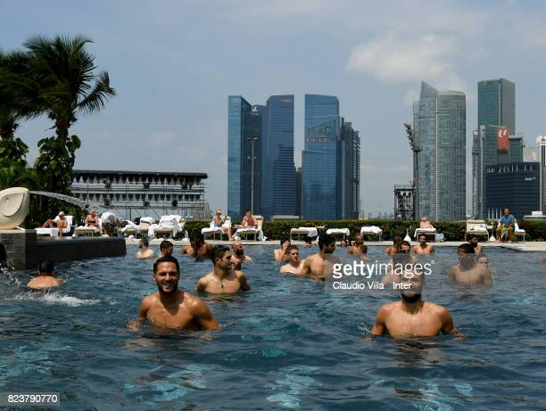 Antonio Candreva and Danilo D'Ambrosio of FC Internazionale in swimming pool after a training session at Mandarin Oriental Hotel on July 28 2017 in...