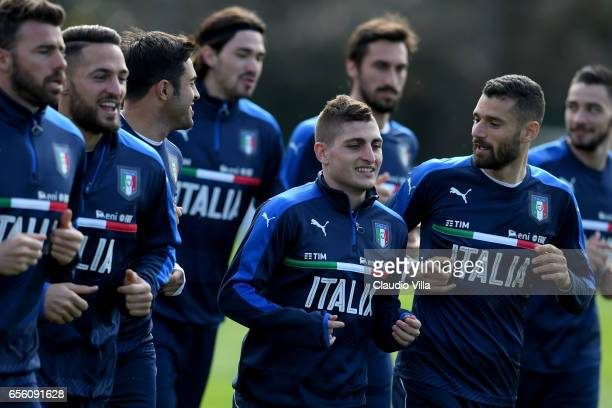 Antonio Candreva and Marco Verratti of Italy chat during the training session at the club's training ground at Coverciano on March 21 2017 in...