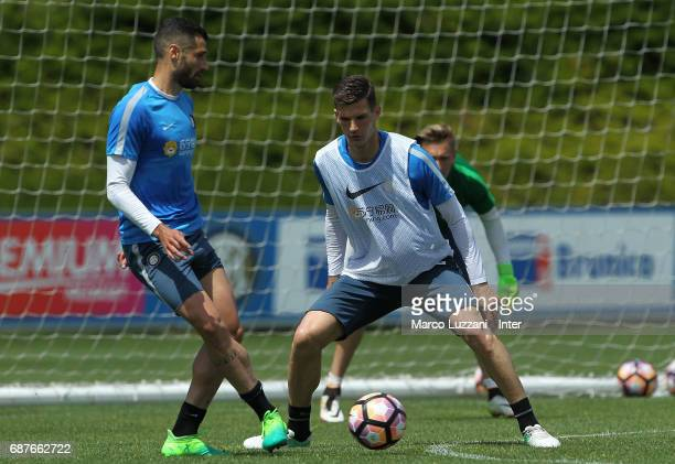 Antonio Candreva is challenged by Marco Andreolli during the FC Internazionale training session at the club's training ground Suning Training Center...