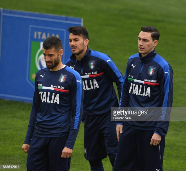 Antonio Candreva Nicola Sansone and Matteo Darmian of Italy look on during the training session at the club's training ground at Coverciano on March...