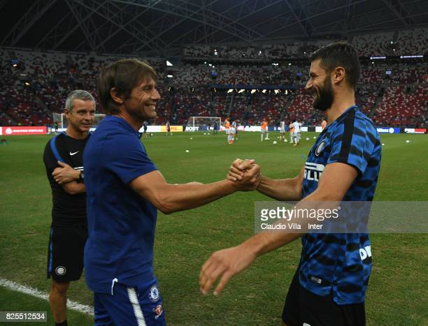 Antonio Candreva of FC Internazionale and Head coach Chelsea Antonio Conte chat prior to the International Champions Cup match between Chelsea FC and...