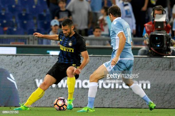 Antonio Candreva of FC Internazionale compete for the ball with Senad Lulic of SS Lazio during the Serie A match between SS Lazio and FC...
