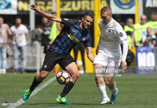 Antonio Candreva of FC Internazionale competes for the ball with Gerard Deulofeu of AC Milan during the Serie A match between FC Internazionale and...
