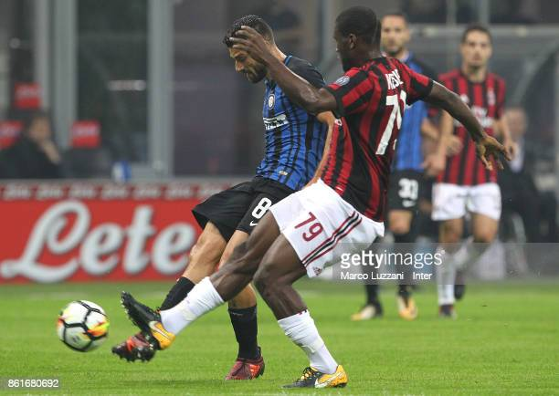 Antonio Candreva of FC Internazionale competes for the ball with Franck Kessie of AC Milan during the Serie A match between FC Internazionale and AC...