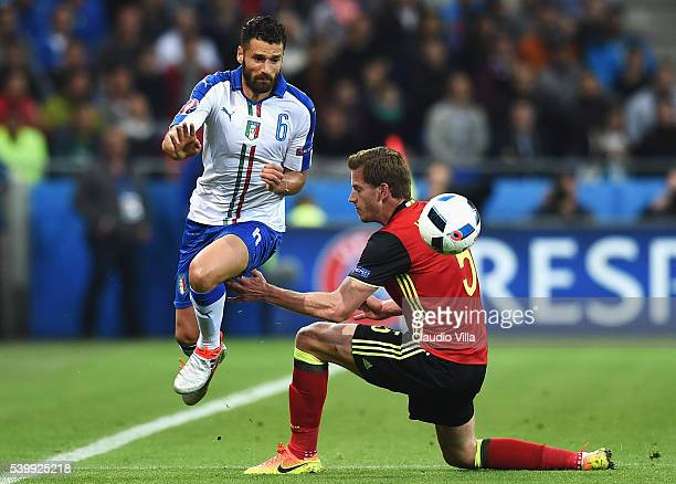 Antonio Candreva of Italy and Jan Vertonghen of Belgium compete for the ball during the UEFA EURO 2016 Group E match between Belgium and Italy at...