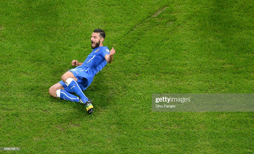 <a gi-track='captionPersonalityLinkClicked' href=/galleries/search?phrase=Antonio+Candreva&family=editorial&specificpeople=4063716 ng-click='$event.stopPropagation()'>Antonio Candreva</a> of Italy celebrates after scoring his opening goal during the EURO 2016 Group H Qualifier match between Italy and Croatia at Stadio Giuseppe Meazza on November 16, 2014 in Milan, Italy.