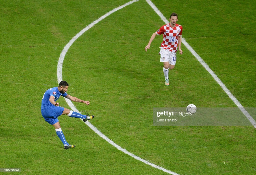 Antonio Candreva of Italy scores his opening goal during the EURO 2016 Group H Qualifier match between Italy and Croatia at Stadio Giuseppe Meazza on...