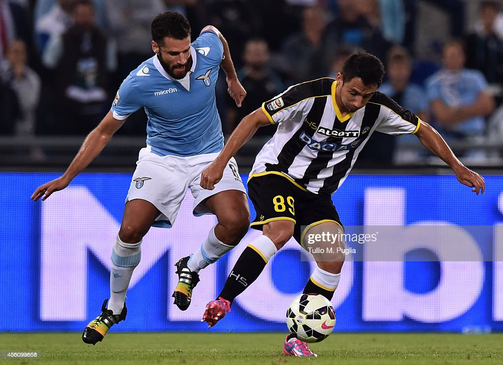 Antonio Candreva (L) of Lazio and Ivan Piris of Udinese compete for the ball during the Serie A match between SS Lazio and Udinese Calcio at Stadio Olimpico on September 25, 2014 in Rome, Italy.