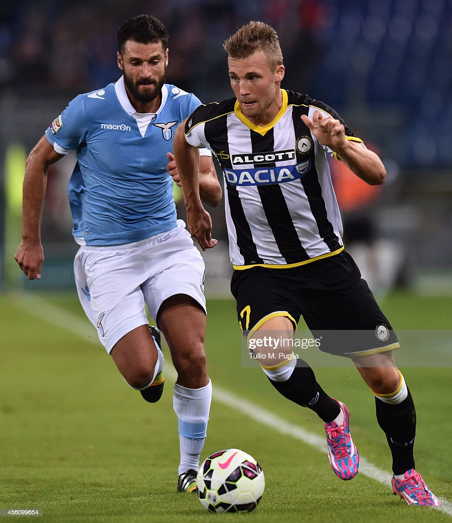 Antonio Candreva (L) of Lazio and Silvan Widmer of Udinese compete for the ball during the Serie A match between SS Lazio and Udinese Calcio at Stadio Olimpico on September 25, 2014 in Rome, Italy.