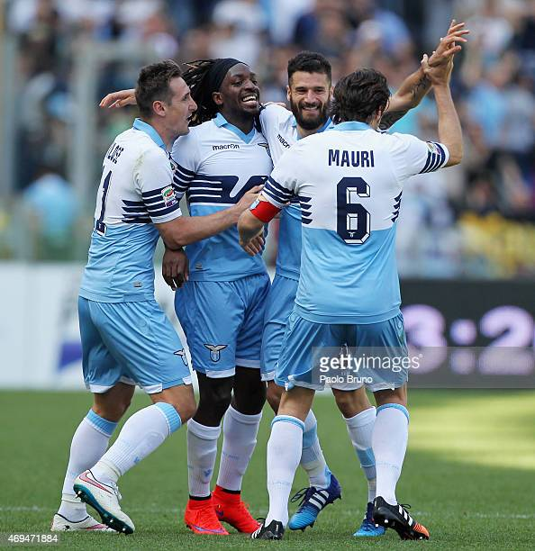 Antonio Candreva of SS Lazio celebrates with his teammates after scoring the team's third goal during the Serie A match between SS Lazio and Empoli...