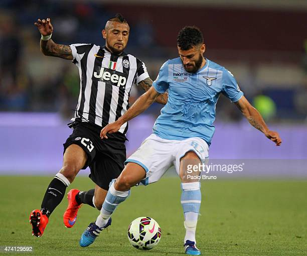Antonio Candreva of SS Lazio competes for the ball with Arturo Vidal of Juventus FC during the TIM Cup final match at Olimpico Stadium on May 20 2015...