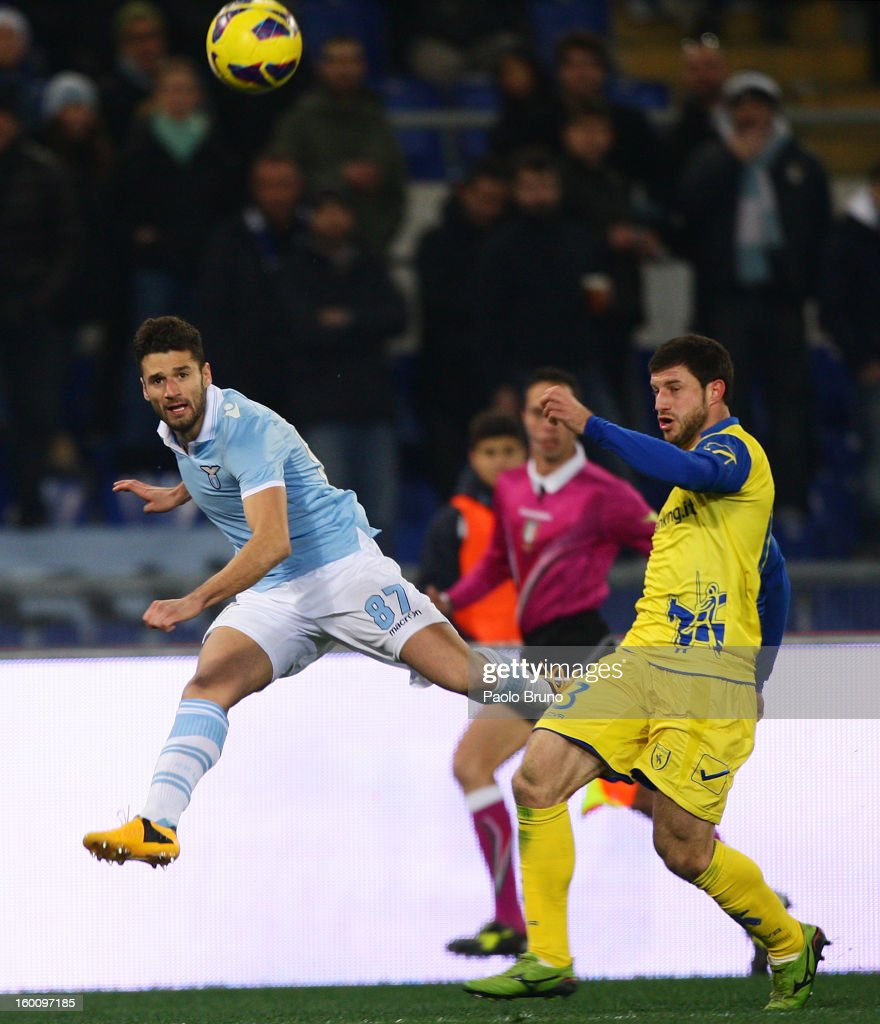 Antonio Candreva (L) of S.S. Lazio competes for the ball with Bojan Jokic of AC Chievo during the Serie A match between S.S. Lazio and AC Chievo Verona at Stadio Olimpico on January 26, 2013 in Rome, Italy.