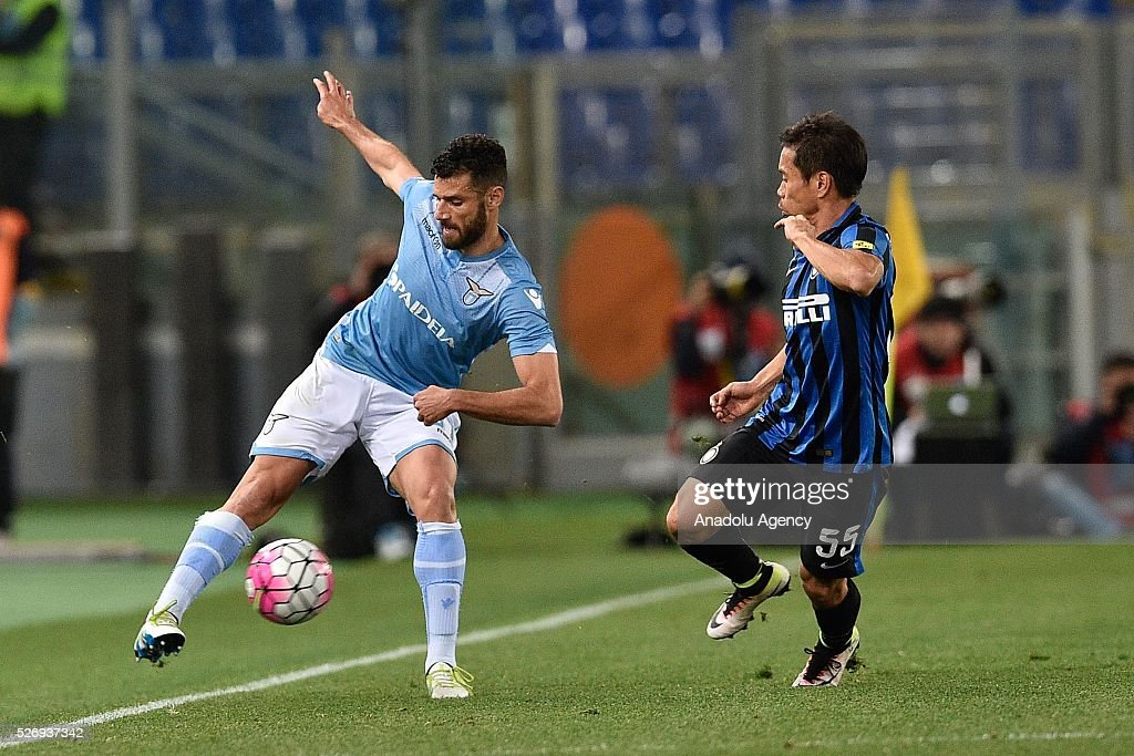 Antonio Candreva (L) of SS Lazio competes for the ball Yuto Nagatomo (R) of FC Inter Milan during the Serie A match between SS Lazio and FC Internazionale Milano at Stadio Olimpico on May 1, 2016 in Rome, Italy.