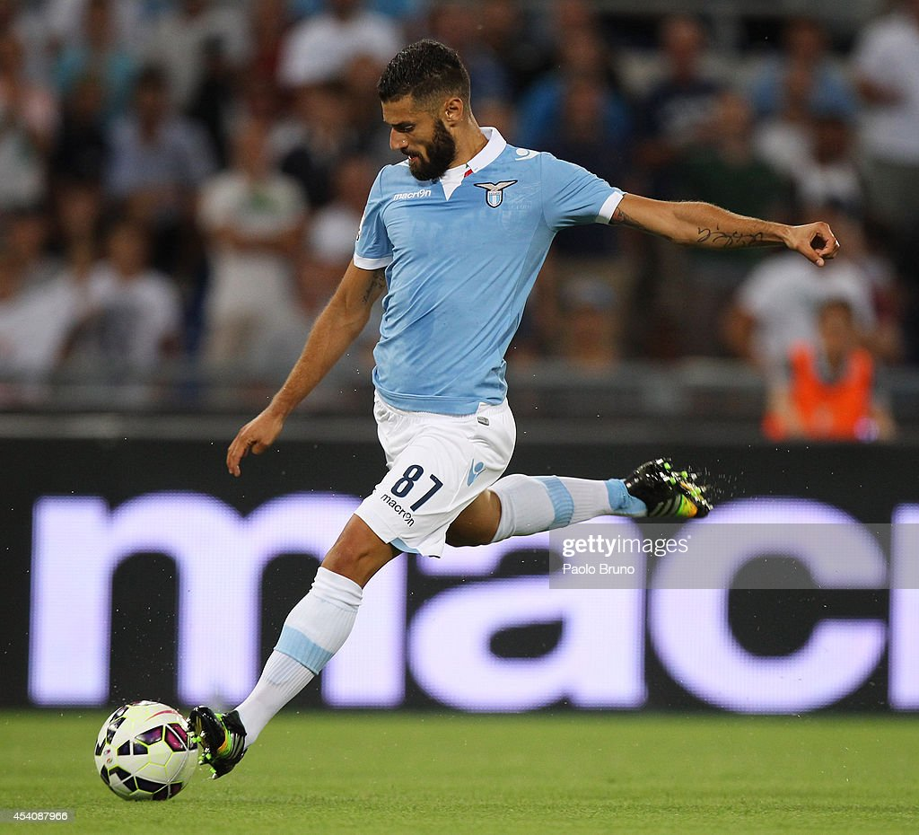 <a gi-track='captionPersonalityLinkClicked' href=/galleries/search?phrase=Antonio+Candreva&family=editorial&specificpeople=4063716 ng-click='$event.stopPropagation()'>Antonio Candreva</a> of SS Lazio scores the opening goal during the TIM Cup match between SS Lazio and Bassano FC at Olimpico Stadium on August 24, 2014 in Rome, Italy.