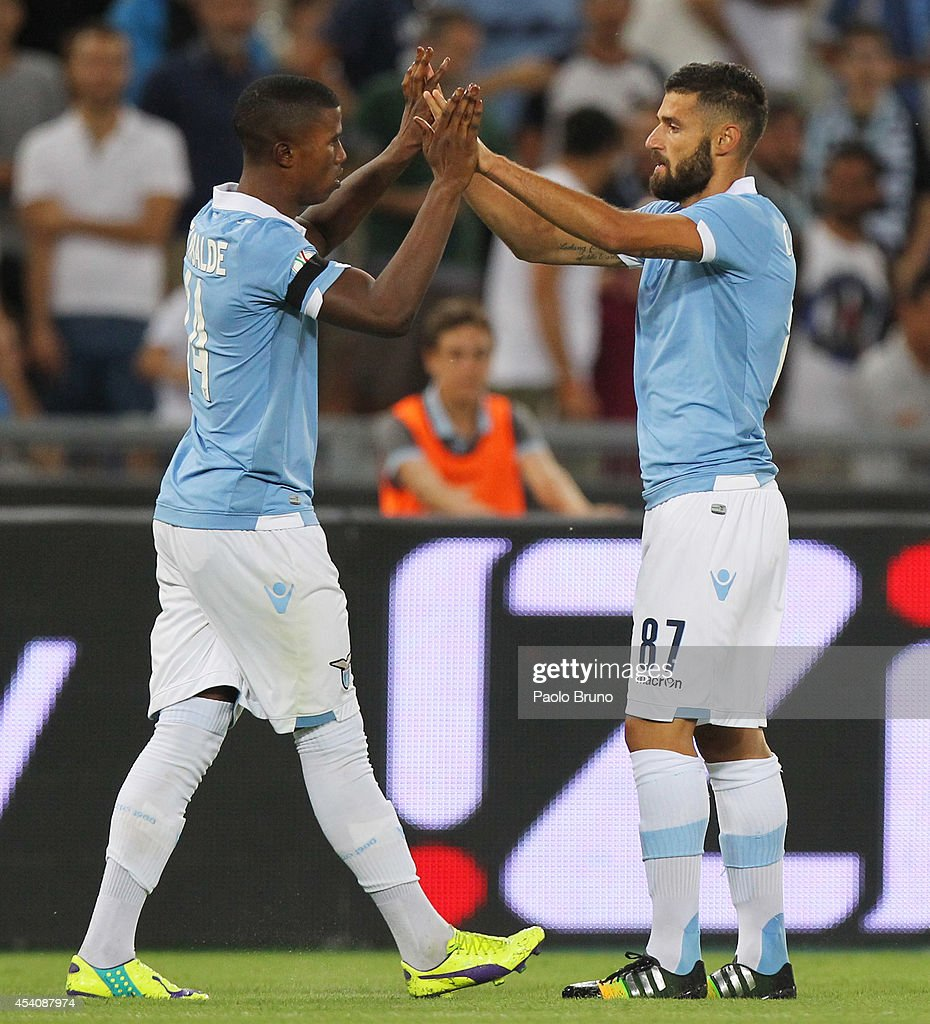 <a gi-track='captionPersonalityLinkClicked' href=/galleries/search?phrase=Antonio+Candreva&family=editorial&specificpeople=4063716 ng-click='$event.stopPropagation()'>Antonio Candreva</a> (R) with his teammate Diao Keita Balde of SS Lazio celebrates after scoring the opening goal during the TIM Cup match between SS Lazio and Bassano FC at Olimpico Stadium on August 24, 2014 in Rome, Italy.