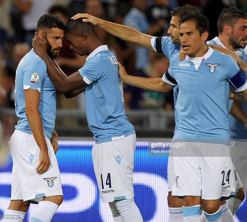<a gi-track='captionPersonalityLinkClicked' href=/galleries/search?phrase=Antonio+Candreva&family=editorial&specificpeople=4063716 ng-click='$event.stopPropagation()'>Antonio Candreva</a> (L) with his teammate Diao Keita Balde #14 of SS Lazio celebrates after scoring the opening goal during the TIM Cup match between SS Lazio and Bassano FC at Olimpico Stadium on August 24, 2014 in Rome, Italy.