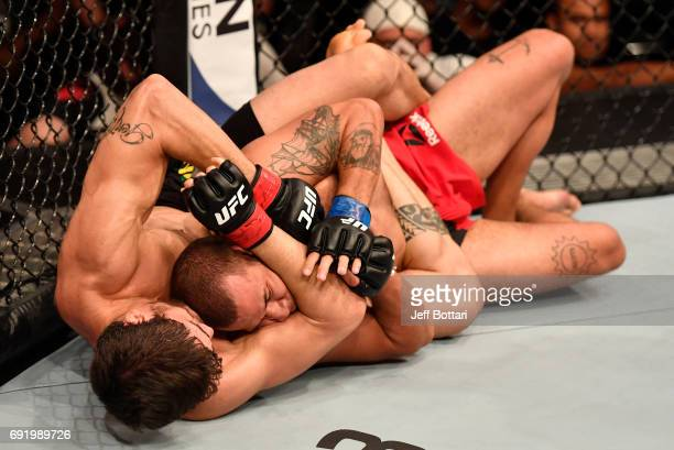 Antonio Carlos Junior of Brazil attempts to secure a rear choke submission against Eric Spicely in their middleweight bout during the UFC 212 event...