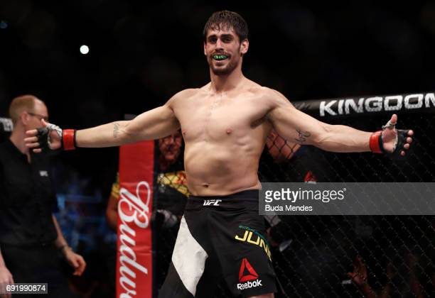 Antonio Carlos Junior of Brazil celebrates after his submission victory over Eric Spicely in their middleweight bout during the UFC 212 event at...