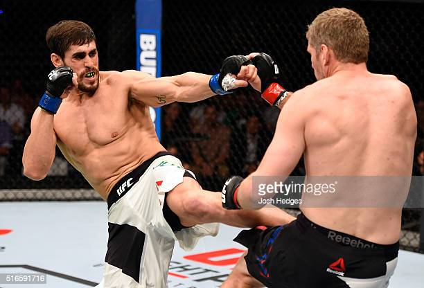 Antonio Carlos Junior of Brazil kicks Daniel Kelly of Australia in their middleweight bout during the UFC Fight Night event at the Brisbane...