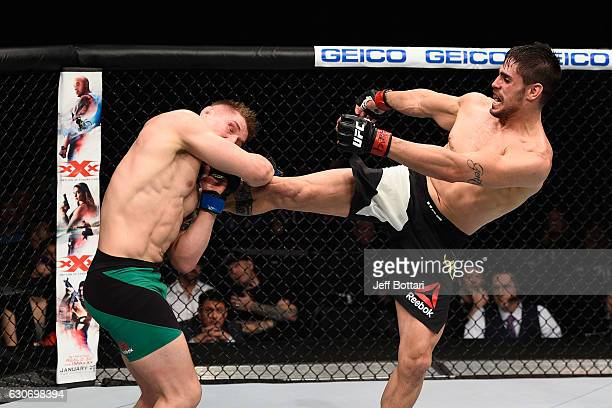 Antonio Carlos Junior of Brazil kicks Marvin Vettori of Italy in their middleweight bout during the UFC 207 event at TMobile Arena on December 30...