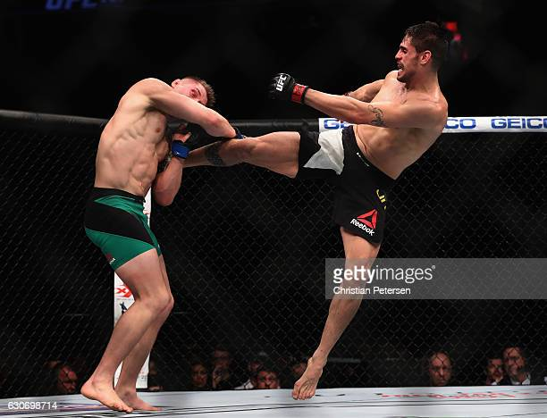 Antonio Carlos Junior of Brazil kicks Marvin Vettori of Italy in their middleweight bout during the UFC 207 event on December 30 2016 in Las Vegas...