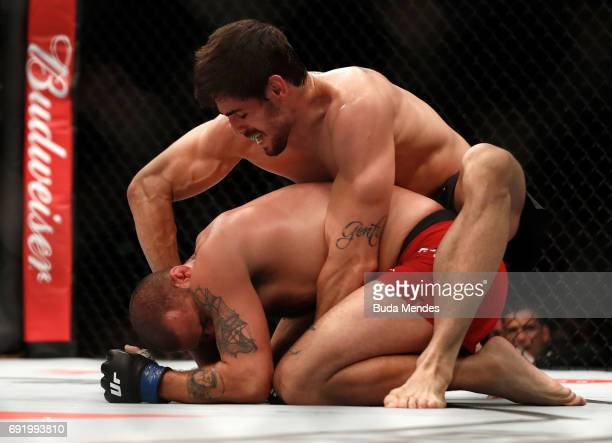 Antonio Carlos Junior of Brazil punches Eric Spicely in their middleweight bout during the UFC 212 event at Jeunesse Arena on June 3 2017 in Rio de...