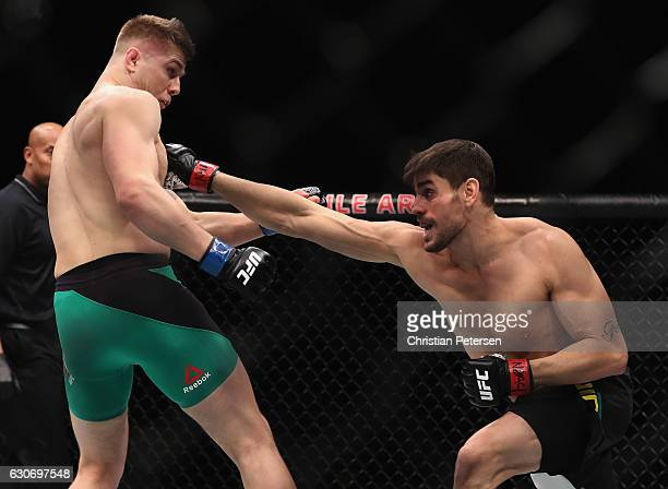 Antonio Carlos Junior of Brazil punches Marvin Vettori of Italy in their middleweight bout during the UFC 207 event on December 30 2016 in Las Vegas...