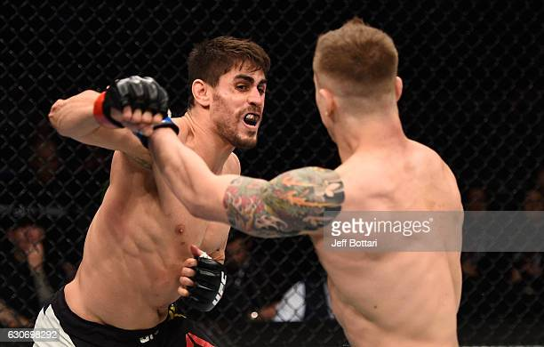 Antonio Carlos Junior of Brazil punches Marvin Vettori of Italy in their middleweight bout during the UFC 207 event at TMobile Arena on December 30...