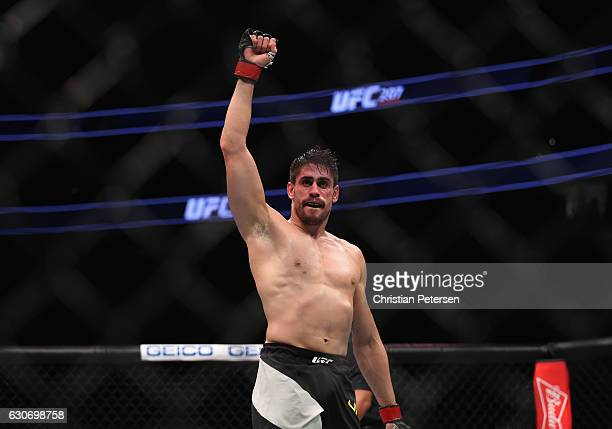 Antonio Carlos Junior of Brazil reacts to his victory over Marvin Vettori of Italy in their middleweight bout during the UFC 207 event on December 30...