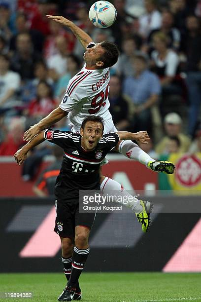 Antonio Cassano AC Milan and Rafinha of Bayern go up for a header during the Audi Cup match between FC Bayern Muenchen and AC Milan at Allianz Arena...