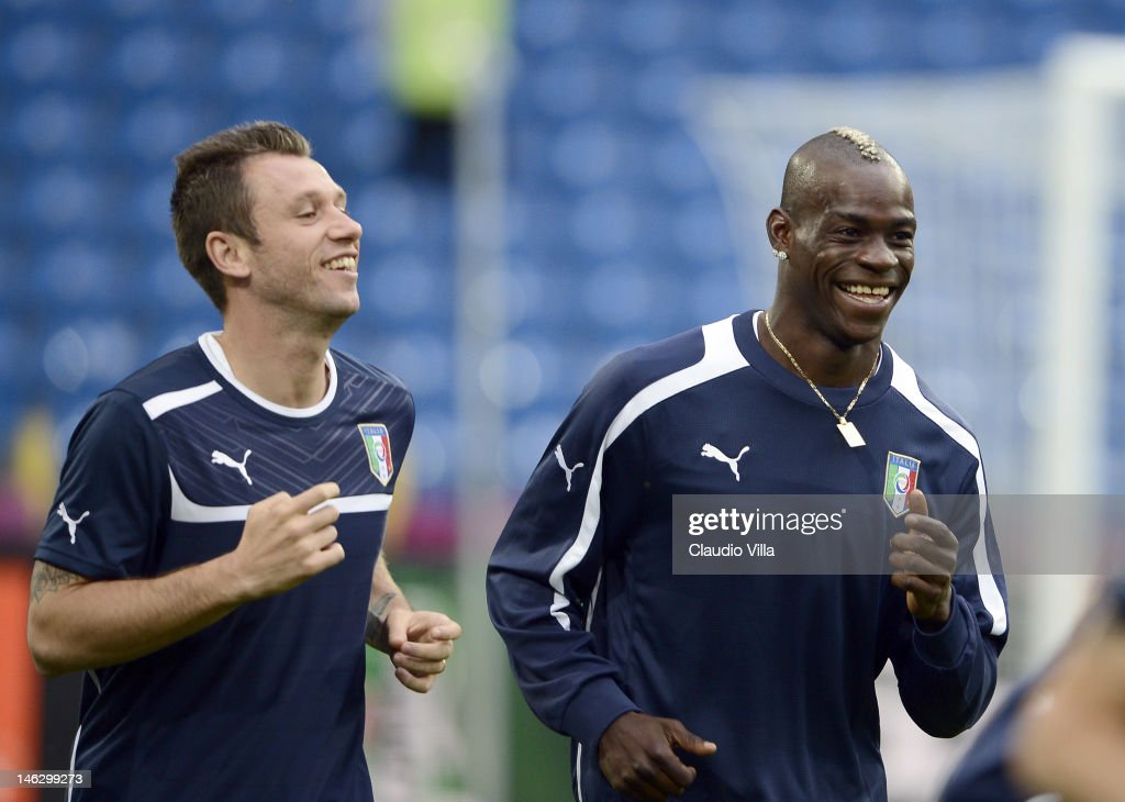 <a gi-track='captionPersonalityLinkClicked' href=/galleries/search?phrase=Antonio+Cassano&family=editorial&specificpeople=214558 ng-click='$event.stopPropagation()'>Antonio Cassano</a> and <a gi-track='captionPersonalityLinkClicked' href=/galleries/search?phrase=Mario+Balotelli&family=editorial&specificpeople=4940446 ng-click='$event.stopPropagation()'>Mario Balotelli</a> of Italy during a UEFA EURO 2012 training session at the Municipal Stadium on June 13, 2012 in Poznan, Poland.