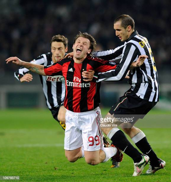 Antonio Cassano of AC Milan is challenged by Giorgio Chiellini of Juventus FC during the Serie A match between Juventus FC and AC Milan at Olimpico...