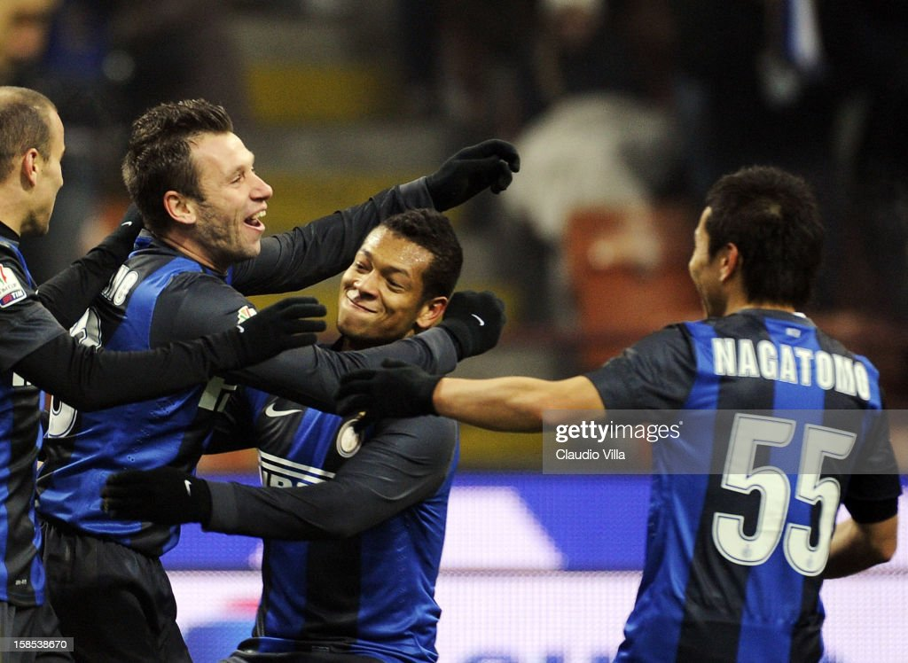 <a gi-track='captionPersonalityLinkClicked' href=/galleries/search?phrase=Antonio+Cassano&family=editorial&specificpeople=214558 ng-click='$event.stopPropagation()'>Antonio Cassano</a> of FC Inter (L) celebrates scoring the first goal during the TIM Cup match between FC Internazionale Milano and Hellas Verona at San Siro Stadium on December 18, 2012 in Milan, Italy.