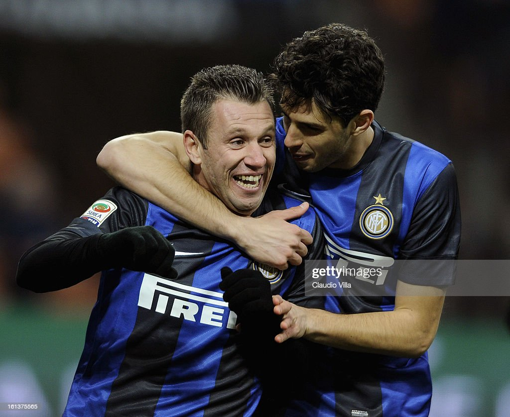<a gi-track='captionPersonalityLinkClicked' href=/galleries/search?phrase=Antonio+Cassano&family=editorial&specificpeople=214558 ng-click='$event.stopPropagation()'>Antonio Cassano</a> (L) of FC Inter Milan celebrates after scoring the opening goal of the Serie A match between FC Internazionale Milano and AC Chievo Verona at San Siro Stadium on February 10, 2013 in Milan, Italy.