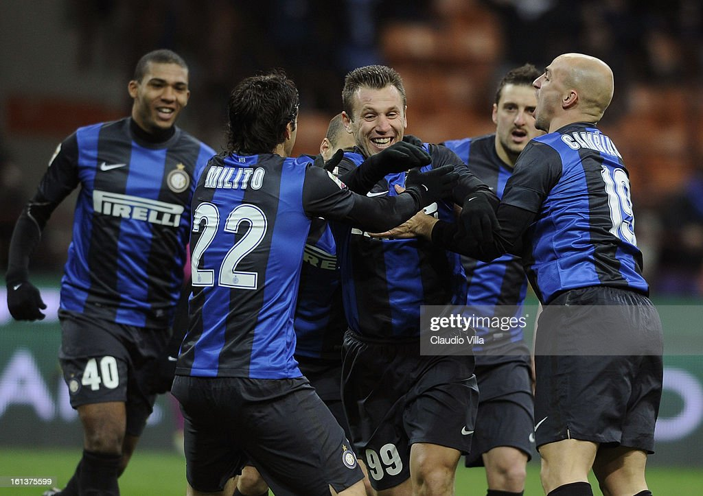<a gi-track='captionPersonalityLinkClicked' href=/galleries/search?phrase=Antonio+Cassano&family=editorial&specificpeople=214558 ng-click='$event.stopPropagation()'>Antonio Cassano</a> #99 of FC Inter Milan celebrates with team-mates after scoring the opening goal of the Serie A match between FC Internazionale Milano and AC Chievo Verona at San Siro Stadium on February 10, 2013 in Milan, Italy.