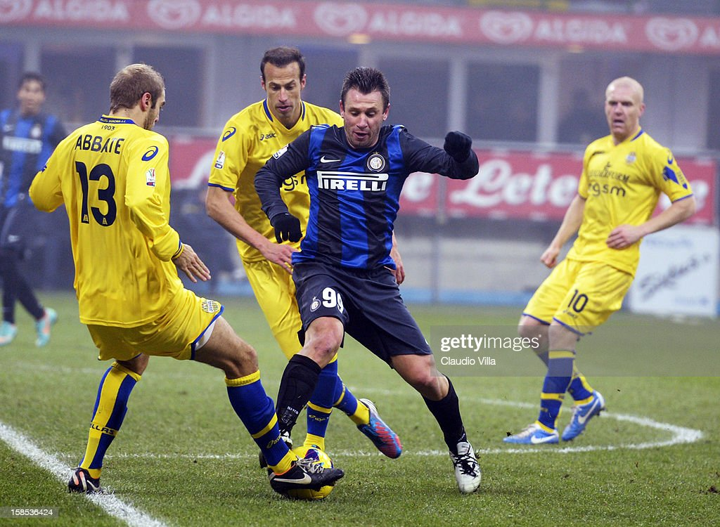 <a gi-track='captionPersonalityLinkClicked' href=/galleries/search?phrase=Antonio+Cassano&family=editorial&specificpeople=214558 ng-click='$event.stopPropagation()'>Antonio Cassano</a> of FC Inter Milan (C) during the TIM Cup match between FC Internazionale Milano and Hellas Verona at San Siro Stadium on December 18, 2012 in Milan, Italy.