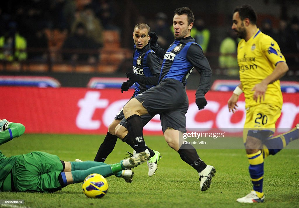 <a gi-track='captionPersonalityLinkClicked' href=/galleries/search?phrase=Antonio+Cassano&family=editorial&specificpeople=214558 ng-click='$event.stopPropagation()'>Antonio Cassano</a> of FC Inter (C) scores the first goal during the TIM Cup match between FC Internazionale Milano and Hellas Verona at San Siro Stadium on December 18, 2012 in Milan, Italy.