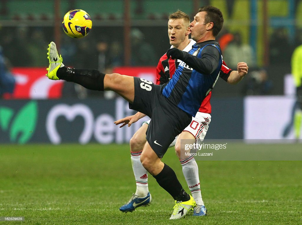 Antonio Cassano of FC Internazionale Milano competes for the ball with Ignazio Abate of AC Milan during the Serie A match FC Internazionale Milano and AC Milan at San Siro Stadium on February 24, 2013 in Milan, Italy.