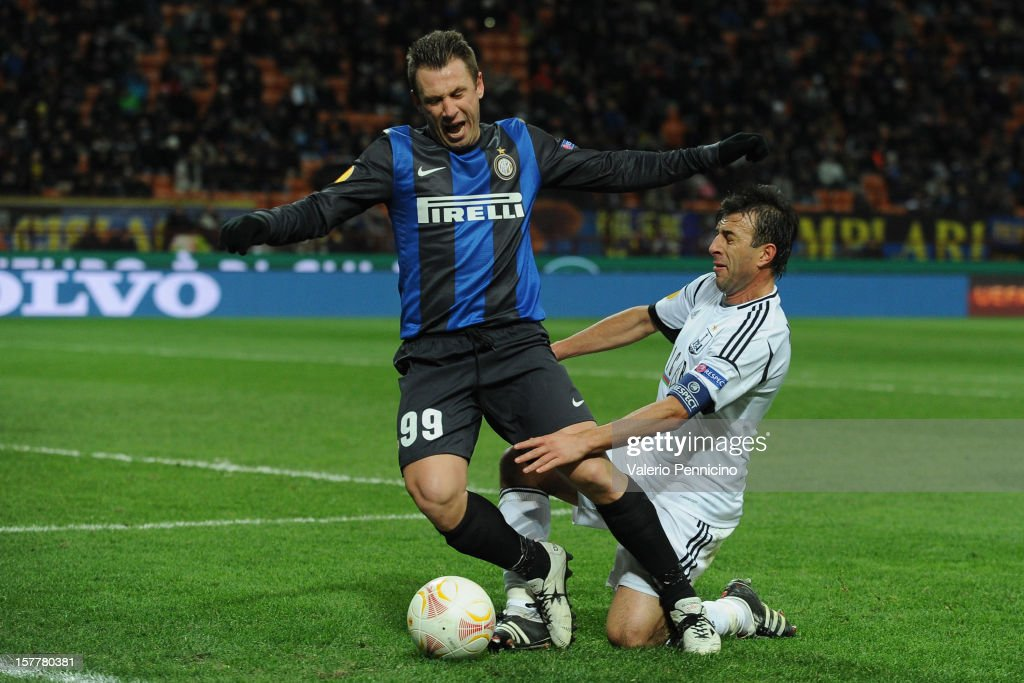 Antonio Cassano (L) of FC Internazionale Milano is tackled by Igor Mitreski of Neftci PFK during the UEFA Europa League group H match between FC Internazionale Milano and Neftci PFK on December 6, 2012 in Milan, Italy.