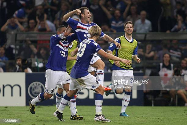 Antonio Cassano of Genua celebrates with his team mates after scoring his team's third goal during the Uefa Champions League qualifying second leg...
