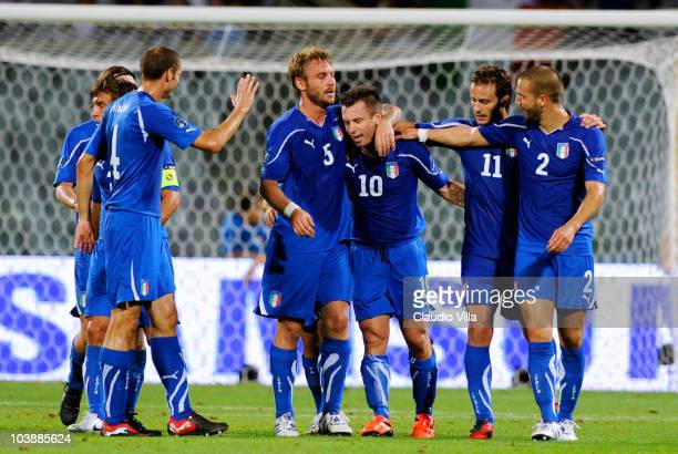 Antonio Cassano of Italy celebrates with his team mates after scoring his team's third goal during the Euro 2012 qualifying match between Italy anf...