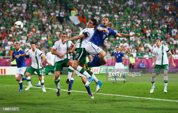 Antonio Cassano of Italy heads in the opening goal during the UEFA EURO 2012 group C match between Italy and Ireland at The Municipal Stadium on June...