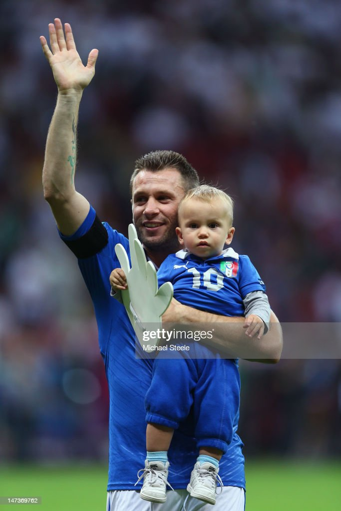 <a gi-track='captionPersonalityLinkClicked' href=/galleries/search?phrase=Antonio+Cassano&family=editorial&specificpeople=214558 ng-click='$event.stopPropagation()'>Antonio Cassano</a> of Italy waves to the fans as he holds his son Christopher Cassano during the UEFA EURO 2012 semi final match between Germany and Italy at the National Stadium on June 28, 2012 in Warsaw, Poland.