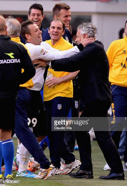 Antonio Cassano of Parma FC celebrates after scoring the first goal with his head coach Roberto Donadoni during the Serie A match between AC Milan...