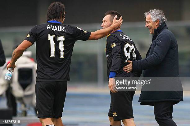Antonio Cassano of Parma FC celebrates his goal with his manager Roberto Donadoni and Amauri Carvalho De Oliveira during the Serie A match between AC...