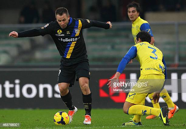 Antonio Cassano of Parma FC competes for the ball with Dario Dainelli of AC Chievo Verona during the Serie A match between AC Chievo Verona and Parma...