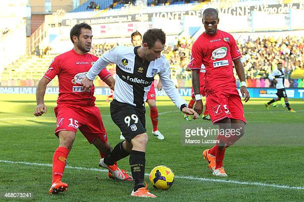 Antonio Cassano of Parma FC competes for the ball with Fabian Andres Rinaudo and German Alexis Rolin Fernandez of Calcio Catania during the Serie A...