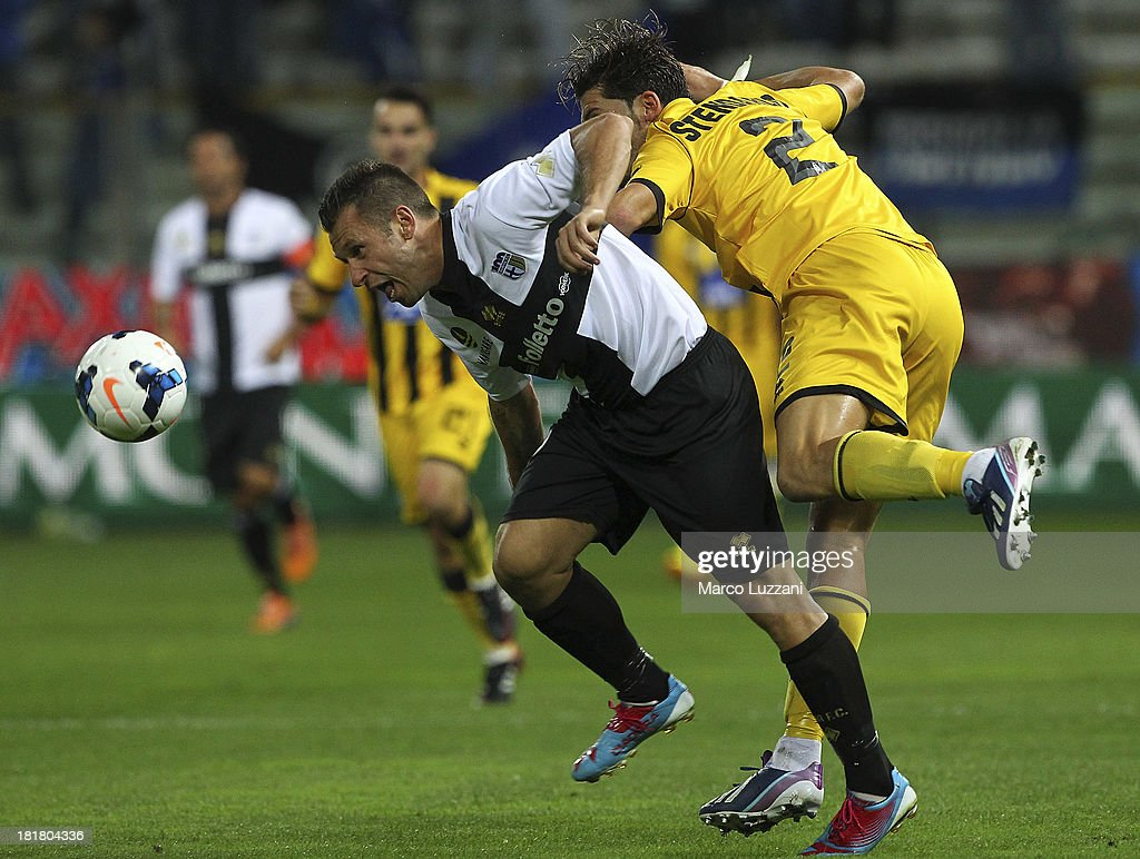 <a gi-track='captionPersonalityLinkClicked' href=/galleries/search?phrase=Antonio+Cassano&family=editorial&specificpeople=214558 ng-click='$event.stopPropagation()'>Antonio Cassano</a> of Parma FC competes for the ball with Guglielmo Stendardo of Atalanta BC during the Serie A match between Parma FC and Atalanta BC at Stadio Ennio Tardini on September 25, 2013 in Parma, Italy.